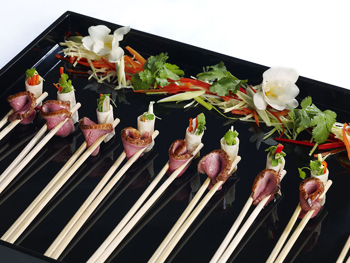Rare peking duck and crispy vegetable bundles with hoi sin