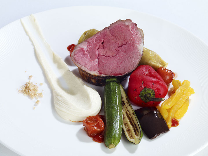 Rare rump of lamb served in a hazelnut crumble, shoulder cannelloni, cauliflower puree, vine vegetable ratatouille