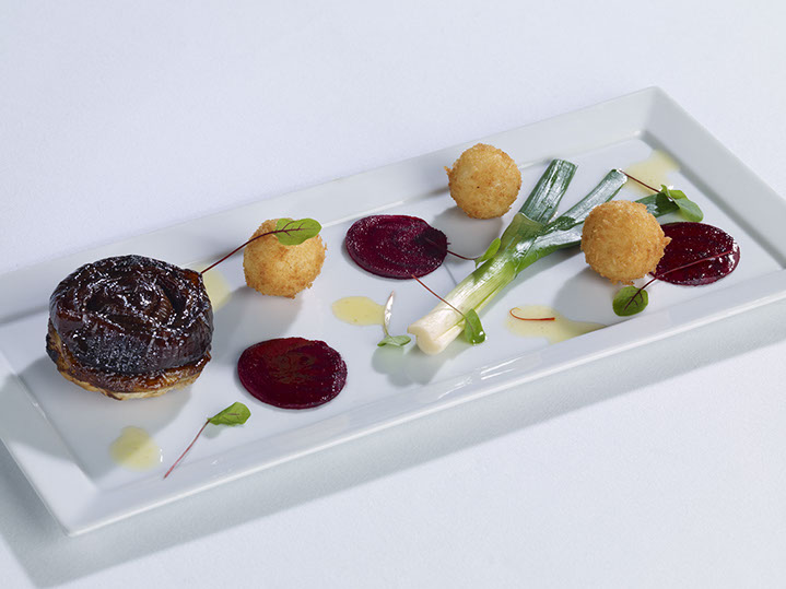 s red onion and balsamic tatin, carpaccio of beetroot, goats cheese bonbons and red chard