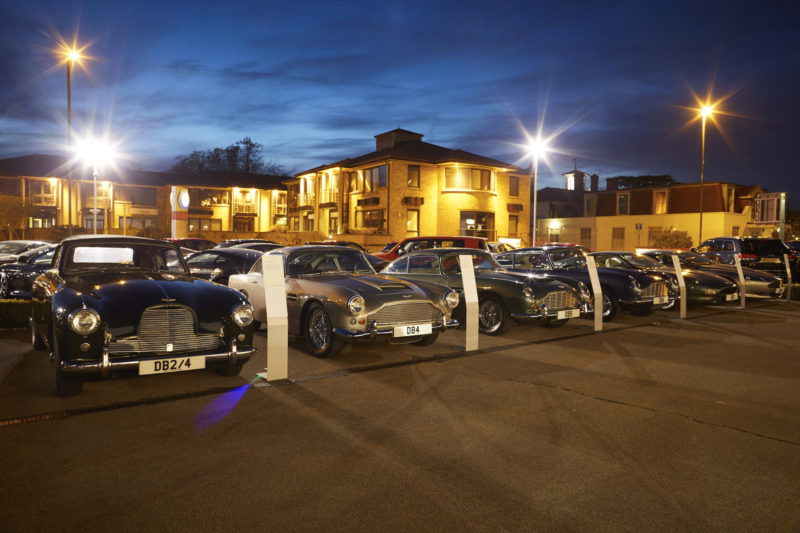 A car park full of classic Aston Martin cars for the launch of the DB11