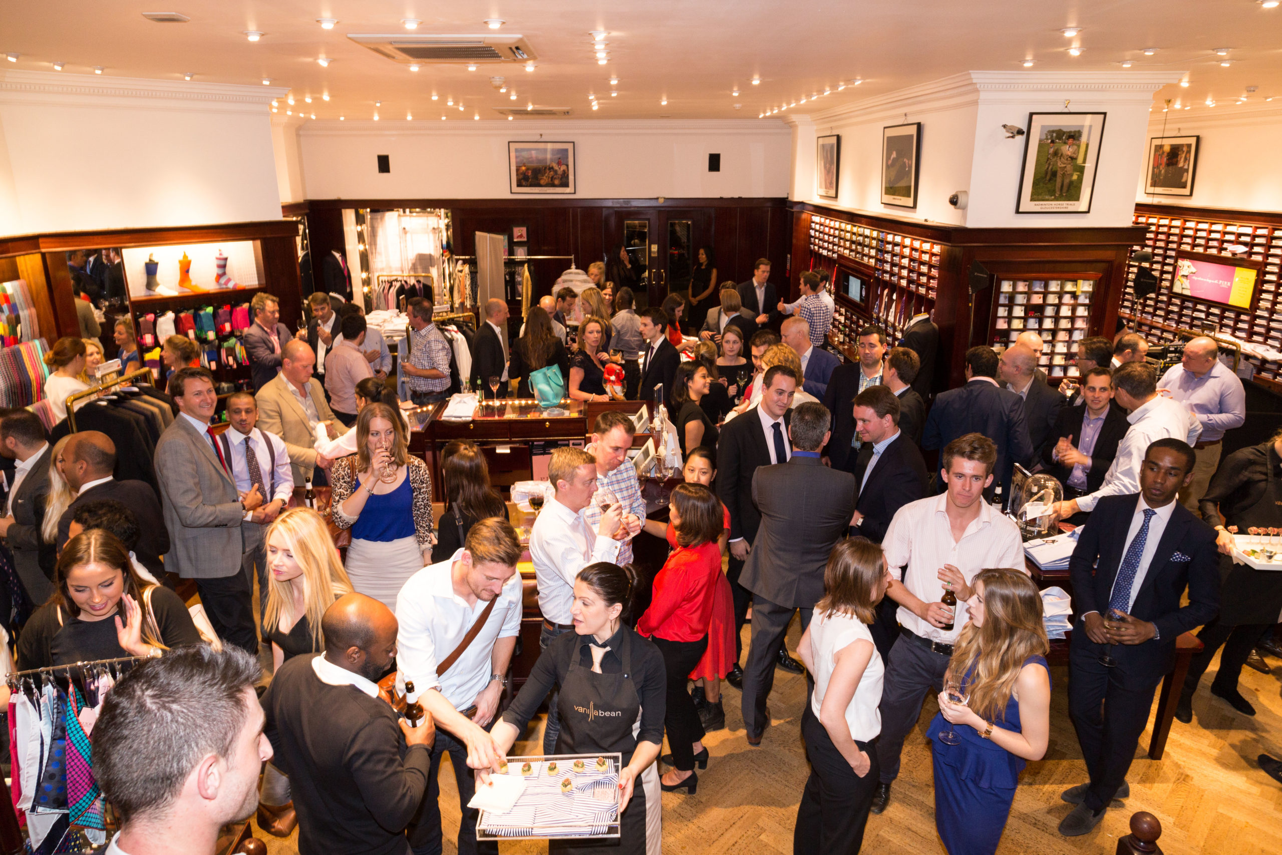 Guests mingle at a Thomas Pink Corporate networking event